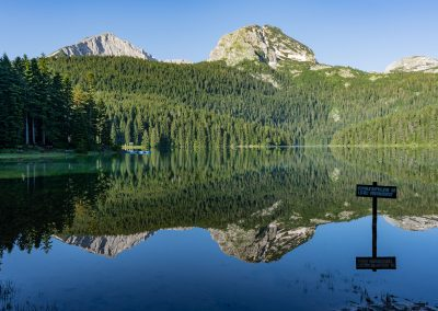 Mountain peaks reflected in a clear lake